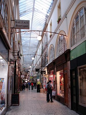 Arcades Project - View of an arcade (the passage Choiseul, located in the second arrondissement of Paris), as an example of the characteristic architecture of the covered arcades of 19th-century Paris.