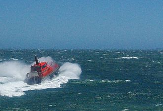 Fremantle Doctor - Pilot boat Parmelia facing the Fremantle Doctor at the Fremantle harbour entrance