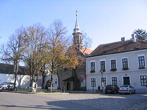 Heiligenstadt St. James's Church - The Pfarrplatz. St. James's Church stands in the middle, the former Heiligenstadt primary school is on the right