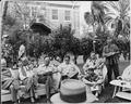 """Photograph of some of the reporters assembled in the garden of the """"Little White House"""" at Key West, Florida, for... - NARA - 200552.tif"""