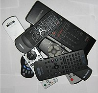 A pile of various remote controls