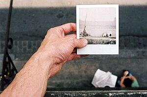 polaroid photograph on photograph