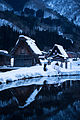 Pond and buildings in Shirakawago (12723159813).jpg
