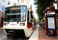 Portland TriMet MAX Blue Line at the Pioneer Square South stop in downtown Portland, Oregon.png