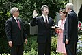 President George W. Bush looks on as Justice Anthony Kennedy swears in Brett Kavanaugh in the Rose Garden.jpg
