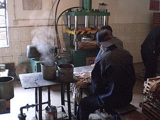 Pu'er tea - A pu'er tea factory, which steams, bags, and presses the loose leaf pu'er into tea bricks