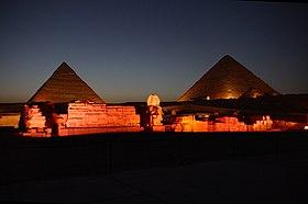 The Giza pyramid complex at night.