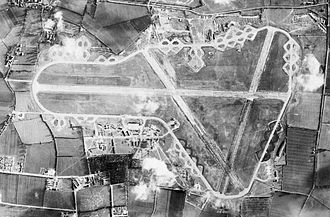 RAF Fairford - Aerial photograph of Fairford airfield, the bomb dump and ammunition dump are east (top) of the perimeter track, the technical site and barrack sites are on the north (lower left), 2 December 1943.