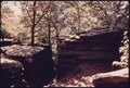 ROCK LEDGES AND TREES OFFER BEAUTY AND SOLITUDE FOR HIKERS IN THE VIRGINIA KENDALL PARK, PART OF THE AKRON, OHIO... - NARA - 558083.tif