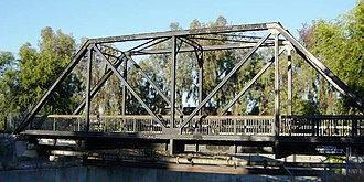 Truss - Truss bridge for a single-track railway, converted to pedestrian use and pipeline support