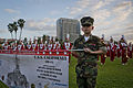 Raven Pridemore, a private in the Young Marines, holds up a banner.jpg