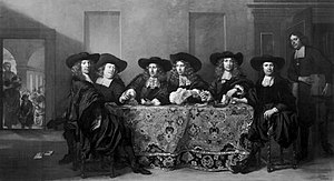 Pieter van Anraedt - Regents of the Huiszitten House. From left to right: Ferdinand Bol, Aarnhout van der Cruijs, Anthony Hoevenaer, Jan van Beuningen, Isaac Commelin, Aarnout Schuyt, Symon Leeman (standing). Bol was one of the regents and lived on the Oudezijds Voorburgwal. For many years in the 19th century the painting was misattributed to him.