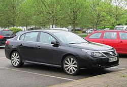 Renault Latitude photographed (slightly incongruously) in the visitors' car park at the Peugeot Museum in Sochaux.JPG
