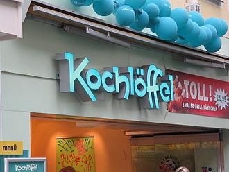 Kochlöffel - Neon sign above the entrance to a Kochlöffel restaurant.