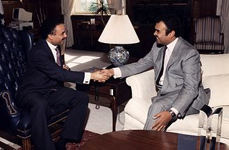 Commerce Department trade mission controversy - U.S. Secretary of Commerce Ron Brown (left) shaking hands at a meeting.