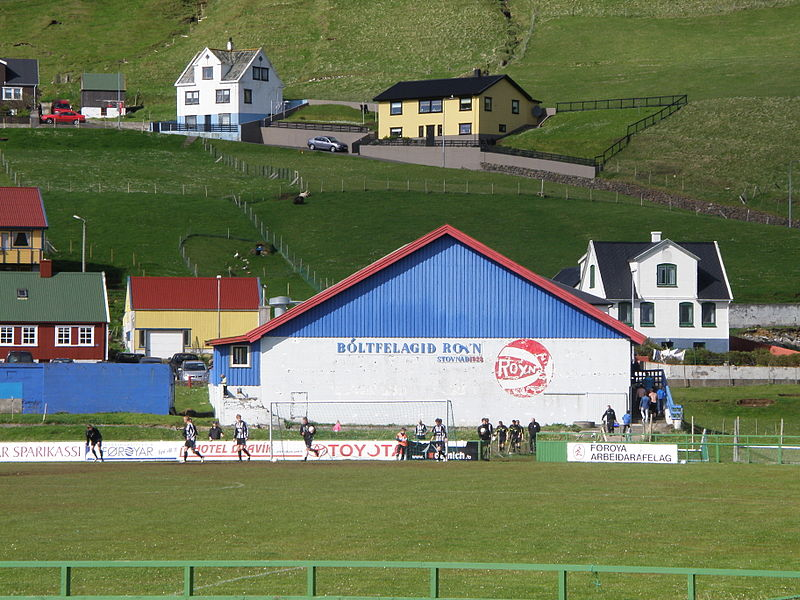 File:Roynhollin in Hvalba and the Football Field.JPG