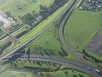 New Zealand State Highway 20 - Aerial view of the interchange between SH 20 (diagonal from bottom left to upper right) and SH 20A towards the airport (towards bottom right).