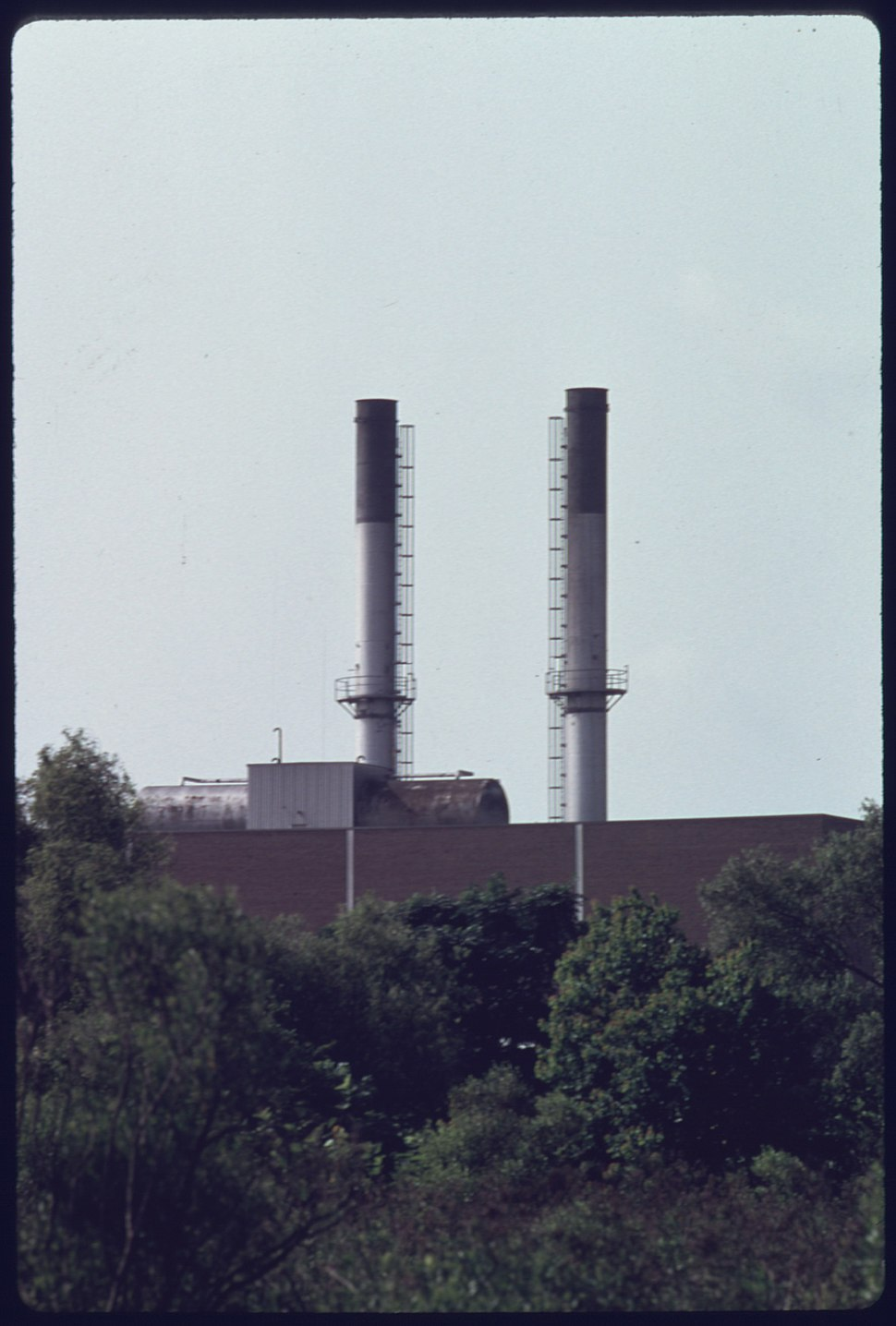 SMOKESTACKS OF THE HOLMES ROAD INCINERATOR, NO LONGER POLLUTE THE ATMOSPHERE. THE PLANT PREVIOUSLY BURNED OLD... - NARA - 557411