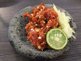 Sambal - Traditional sambal terasi served on stone mortar with garlic and lime