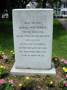"A picture of a monument for Samuel Whittemore with the inscription ""Near this spot, Samuel Whittemore, then 80 years old, killed three British soldiers, April 19, 1775.  He was shot, bayoneted, beaten and left for dead, but recovered and lived to be 96 years of age."""