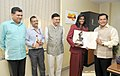 Sarbananda Sonowal conferring the Arjuna Award-2015 on Ms. M.R. Poovamma for her outstanding performance in Athletics, in New Delhi on September 29, 2015.jpg