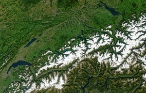 Swiss Alps - Satellite image of Switzerland in October 2002. On the north side of the Alps, the regions located above 2000m are covered by snow. The canton of Ticino (on the south side) is almost snow-free in early autumn.