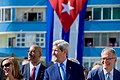 "Secretary Kerry Laughs as the Crowd Across the Street Yells ""Viva Cuba"" at End of Playing of Cuban National Anthem (20564842702).jpg"