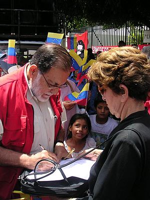 Farabundo Martí National Liberation Front - Schafik Handal hands over a declaration of solidarity to the Ambassador of Venezuela