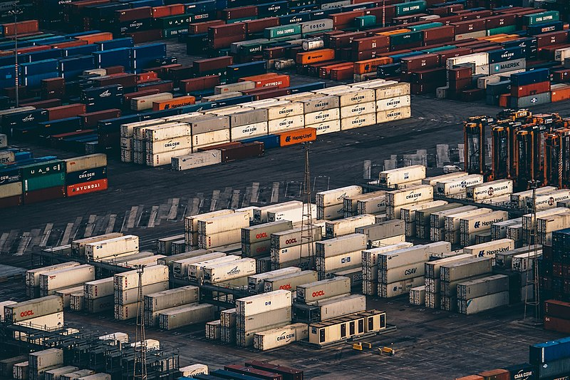 File:Shipping containers in a port (Unsplash).jpg