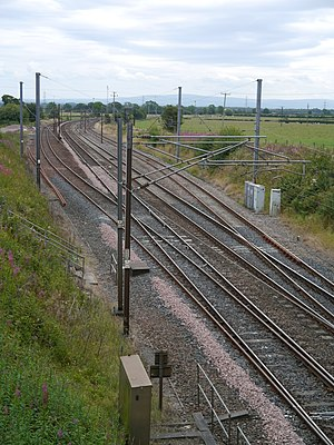 Quintinshill rail disaster - Site of the disaster photographed in 2014. Left to right: up loop; up main (where the first collision occurred); down main; down loop. The signal box was on the outside of the up loop.