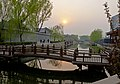 Smoggy sunset over canal near Qianhai Lake, Beijing.jpg