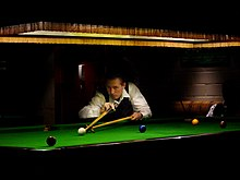 Snooker player with rest.jpg