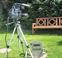 Large video camera outdoors on tripod