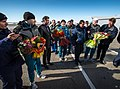 Soyuz TMA-06M crew members are greeted at the Kustanay Airport.jpg