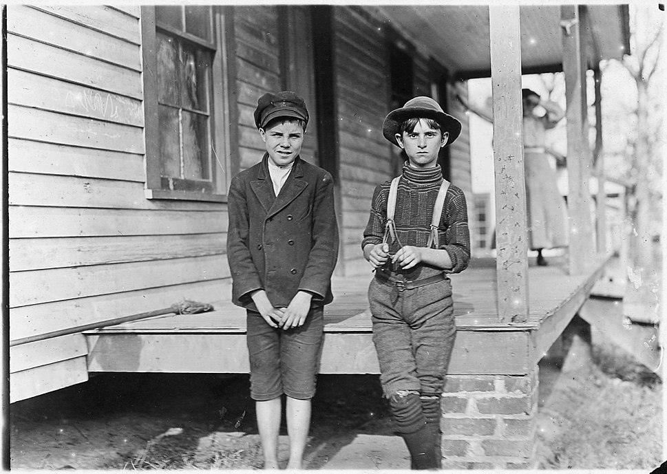 Springstein Mill. John Lewis (boy with hat), 12 years old, 1 year in mill. Weaver - 4 looms. 40 (cents) a day to... - NARA - 523117