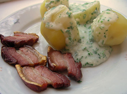 Stegt flæsk is a dish of fried bacon from Denmark that is generally served with potatoes and a parsley sauce (med persillesovs).