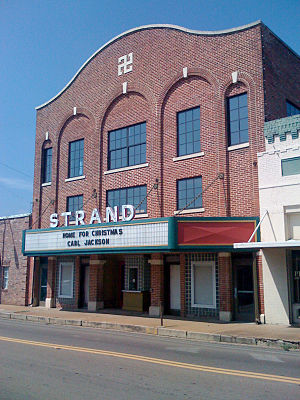Louisville, Mississippi - The historic Strand Theatre in downtown Louisville; note that the Swastika incorporated into the building's facade is decorative rather than political, as the theatre antedates the Nazi era.
