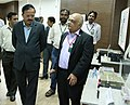 Subhash Ramrao Bhamre being briefed by the Director, Research Centre Imarat (RCI), Shri B.H.V.S. Narayana Murthy about various Avionics Technologies, during his visit to Dr. A.P.J. Abdul Kalam Missile Complex, Hyderabad.jpg