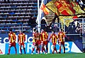 Syrianska supporters waving a flag.jpg