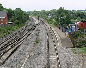 Syston railway station - Station platform, looking north. The fast lines are on the left; the slow line is on the right. The line to Peterborough branches off to the right in the background.