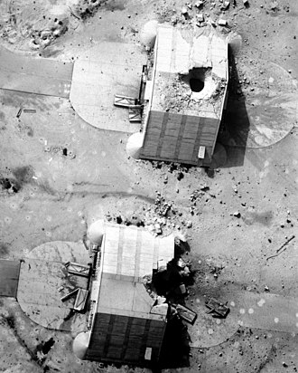 Hardened aircraft shelter - Two reinforced hangars showing the effects of Coalition bombing during Operation Desert Storm, 1991. These Kuwaiti shelters were built by the French and used by Iraqi forces during the conflict. Picture is of Ahmad al-Jaber Air Base - Kuwait.