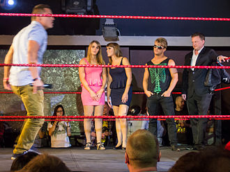TNA British Boot Camp - The contestants on British Boot Camp, from left to right, Marty Scurll, The Blossom Twins, and Rockstar Spud, with Jeremy Borash (far right).