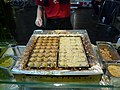 Tako-yaki making (5896216085).jpg