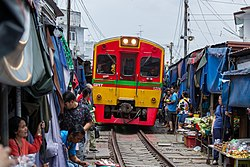 Maeklong Railway Market, also known as Talat Rom Hup when the train arrives