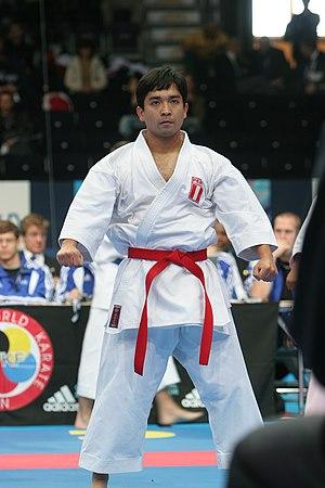 Red belt (martial arts) -  karateka Akio Tamashiro displaying Karate Red belt