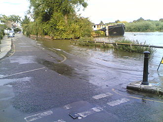 The River Thames flooding at Chiswick Lane South in 2006 Thames flooding at Chiswick Lane South, London W4 (2).jpg