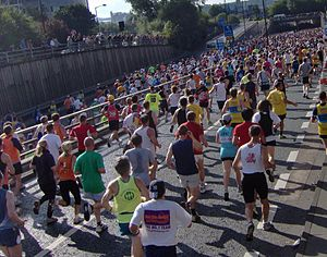 Great North Run - The Great North Run is a mass participation event: two lines of runners merging near the one mile mark.