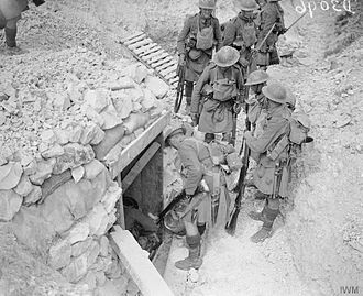 51st (Highland) Division - Battle of the Scarpe. Capture of the Greenland Hill by the 51st Division. Daylight patrol of the 1/6th Battalion, Seaforth Highlanders working forward towards Hausa and Delbar Woods. North-east of Roeux, 29 August 1918. Troops firing into a dug-out in a deserted German trench to dislodge any remaining Germans.