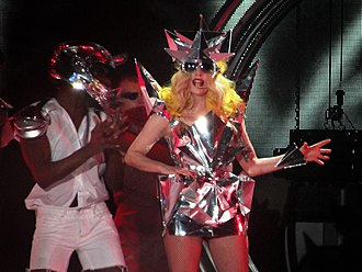 Bad Romance - Gaga performing the song during the revamped Monster Ball Tour in a mirrored dress and headpiece (2010)