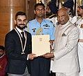 The President, Shri Ram Nath Kovind presenting the Rajiv Gandhi Khel Ratna Award, 2018 to Shri Virat Kohli for Cricket, in a glittering ceremony, at Rashtrapati Bhavan, in New Delhi on September 25, 2018.JPG